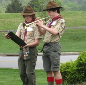 "Fellow Boy Scout Zachary Powell (left) holds the music as Harrison Warren plays ""America the Beautiful"" at the Indian Hannah rededication ceremony at Longwood Gardens."