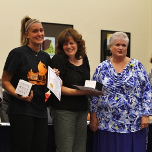 Teachers Kelly Kinderman, Joan Amstutz, and Celia Preston are awarded for having perfect attendance last year.