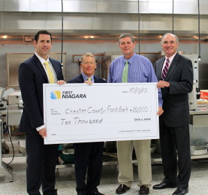 First Niagara's Allan Burkley (from left) poses with Robert MacNeil, board chairman of the Chester County Food Bank; Larry Welsch, its executive director; and Bob Kane, First Niagara's eastern Pennsylvania regional president.