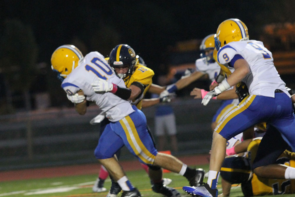 Cougars' running back Daniel Liaudatis (10) powers into the secondary, Friday against Unionville. Jim Gill photo.